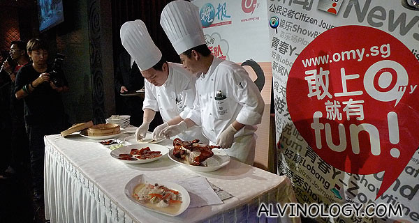 The chefs skillfully skinning the Peking Ducks on-the-spot