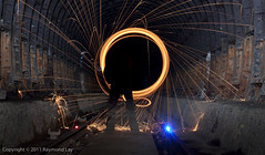 The Vortex Begins (Mondino1980) Tags: blue light shadow red 3 vortex man flower london wool wheel train fire jump wire rust track ghost orb 8 tunnel led raymond lay armed connaught mondino murphyz