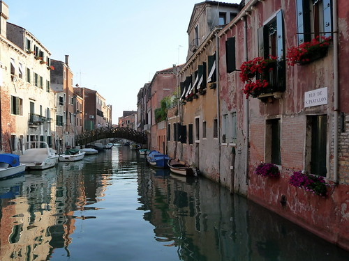 Reflections on quiet canal, Venice, Italy