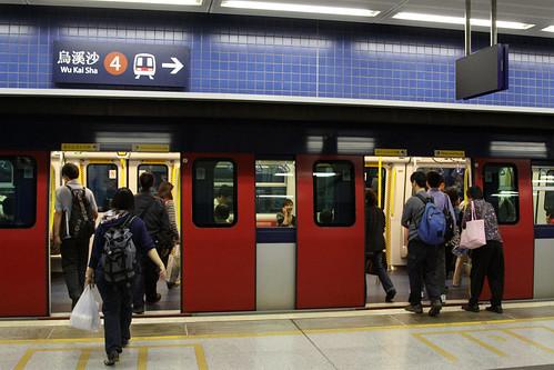 Passengers board a train at Tai Wai station