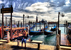 Waiting in Venice (` Toshio ') Tags: city venice people italy woman building history water girl architecture night buildings river bench gold boat canal ancient europe italia european sitting cityscape historical gondola venezia europeanunion toshio
