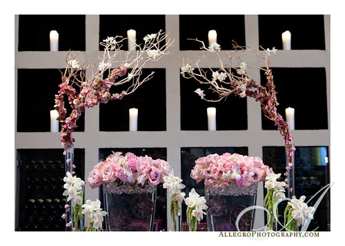 grace-ormonde-tabletop-mimosa-style- detail of willow branches and orchids with candles in background- wedding inspirations- pink white green lavender burgundy