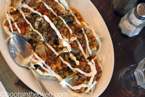 Mantu - dumplings of ground beef, onions and herbs, topped with yogurt