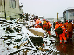 UK search & rescue team work in heavy snow in Kamaishi, Japan (DFID - UK Department for International Development) Tags: rescue japan search earthquake tsunami isar naturaldisaster kamaishi usar humanitarianaid ukgovernment britishgovernment dfid ukaid ukfireservice britishfirefighters