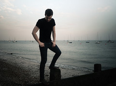 Balancing Thoughts - Southend-on-Sea (mattlindn) Tags: uk blue boy sea portrait england sky selfportrait man male guy beach me water beautiful clouds self matt fun boats coast seaside scenery view happiness august clothes jeans portraiture dreams essex southend 2010
