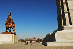 PRK-Pyongyang-0811-236-v1 (anthonyasael) Tags: travel blue sky urban building male statue horizontal architecture buildings photography asia republic exterior time pavement north free posing places landmark korea du structure east clear national anthony theme destination leisure spare far democratic themes pyongyang likeness dprk coreadelnorte asael of    nord  coree scene