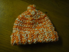 Orange & white baby hat.