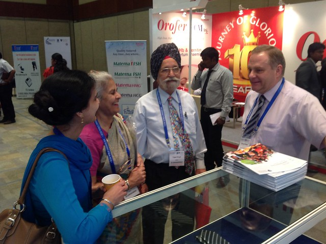 Examinations Chair Ed Neale helping delegates at the RCOG stand, Hyderabad