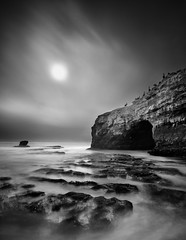Before the Arch (~ superboo ~ [busy busy]) Tags: ocean california bw santacruz sun mist birds stone contrast arch cloudy stones shoreline workshop lee naturalbridges longexp jimpatterson seatosummit joshcripps bigstopper
