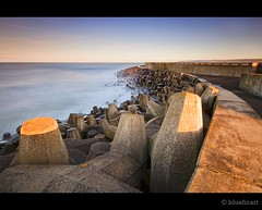 Torness - Looking back (blue fin art) Tags: seascape water wall coast scotland rocks curve powerstation defences lothian torness