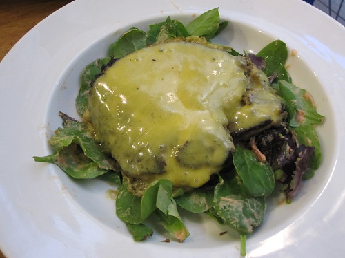 Lentil burger with cheddar, over mixed greens