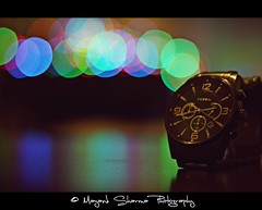 Time.....the cradle of hope ! (Mayank Sharma renewed :D :D) Tags: blue red india black green home metal canon table fossil 50mm lights bokeh delhi watch wristwatch tone chronograph tabletop