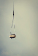 Hanging (*Jilltoo) Tags: newzealand building industry moving movement wire construction crane cable rope chain container nz getty hanging suspended hook skip dangling pulley intheair supported