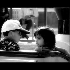 The Ride (Midhun Manmadhan) Tags: blackandwhite children ride amusementpark lookingback