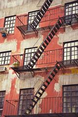 DSC_5862-w1 (adventurediva) Tags: nyc newyorkcity windows colorful westvillage fireescape greenwichvillage redbuilding