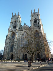 The West Front York Minster (woodytyke) Tags: door york uk blue england sky west building tower english history church window glass stone architecture arch cathedral britain south yorkshire religion north kingdom front stained porch round british minster isles anglican pointed cofe the woodytyke