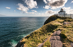 The eastern edge (PRS Images) Tags: ocean blue sky cliff lighthouse newfoundland atlantic capespear nikond90 topazadjust4