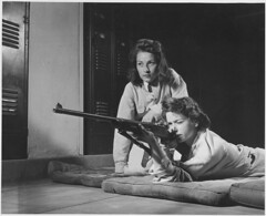 Training in marksmanship helps girls at Roosevelt High School in Los Angeles, Calif., develop into responsible women... (The U.S. National Archives) Tags: ocean new york wedding girls red two snow money west love beach water car sunglasses sex angel lockers computer frank pepper disco losangeles women europe chili ray ipod condoms miami dr sony air south sting wwii rifle teenagers teens delta limo casino gio diamond hills sparkle hamburgers 1940s thongs fries passion land cancun mansion 1942 practice lust hummer h2 corvette success dmv forties aaa suede versace wartime nationalarchives gentlemen firearms iphone marksmanship ipad jordans chilifries nara:arcid=196476 franklindrooseveltlibrary