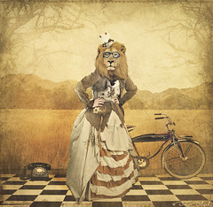 The lion-headed lady who rode a bike (Desire Delgado) Tags: woman girl animal bike lady head telephone lion surreal bicicleta cabeza dreams bici telefono len sueo surrealismo