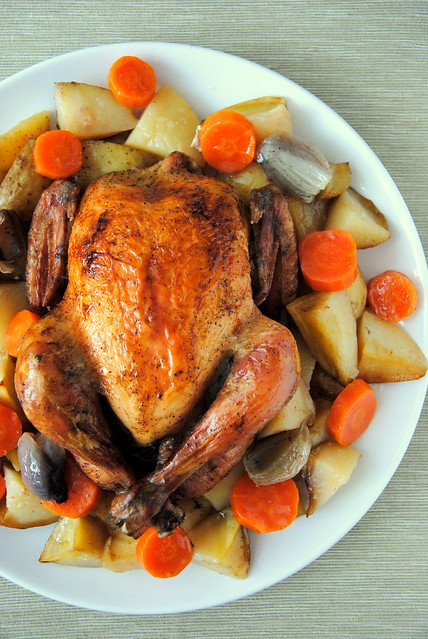 Chicken baked with potatoes and carrots in white wine