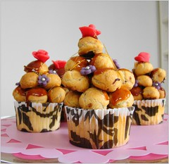 Several croquembouche cupcakes (Cupcakegalore) Tags: croquembouche vanillacupcakes chouxpastries caramelglaze chocolatepastrycream marizpanrose marzipanflowerwithsilverballs