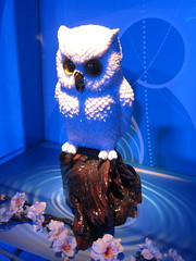 coral gemstone owl carving