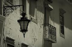 this... (frucht-drops) Tags: portugal lamp lampe architektur architecture abgelegen alt damaged balkony balkon fenster g objekts lichtundschatten outdoor oldusedsupjects pentaxk5 ruins used verfallen window wall bandicoot colours