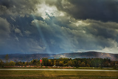 Searchlight (bijoyKetan) Tags: light sun mountains fall colors boston clouds plane flying wings mit dramatic searchlight ketan flyout canon1585mmisusm bijoyketan