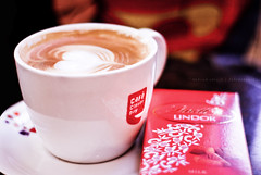Coffee, chocolate, men - some things are just better rich! (Bhavna Saluja) Tags: food men coffee dof heart drink bokeh chocolate superman delicious mug ccd caffeine milkchocolate lindor lindt cafecoffeeday nikond60 coffeechocolatemensomethingsarebetterrich