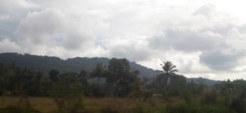 Kinabalu from afar, in a speeding car