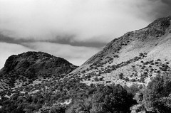 Mountains and Snow Clouds (La Branaro) Tags: blackandwhite mountains southwest film landscape 1 texas olympus 35mmfilm 200 westtexas om ilford om1 fortdavis sfx wideview 166 davismountains americansouthwest davismountainsstatepark scenicdrive fakeinfrared fauxinfrared sfx200 ilfordfilm red25 redfilm scenicloop tiffenfilter tiffenredfilter texas166 texasvista