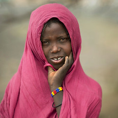Karrayyu young woman - Ethiopia (Eric Lafforgue) Tags: africa people colour girl childhood gabi horizontal youth outside outdoors person kid child veil hijab culture tribal jeunesse innocence tribes shawl tradition ethiopia tribe ethnic enfant fille voile naivete personne humanbeing tribo contemplation afrique ethnology tribu dehors eastafrica enfance carre abyssinia ethiopie exterieur lookingatcamera traditionalclothes waistup squarepicture 5617 abyssinie vueexterieure coloredpicture ethnie photocouleur afriquedelest islamicveil alataille etrehumain voileislamique regardantlobjectif karayu imagecarree karrayyu colouredpicture cadragealataille tribudeskarrayyus karrayyutribe peuplekarrayyu karrayyupeople habittraditionnels ethiopianscarf