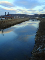 River of Clouds (Celtic~Dancer) Tags: blue sky usa reflection glass clouds river mirror virginia sony roanoke industrialpark sonycybershot roanokeriver dscw80