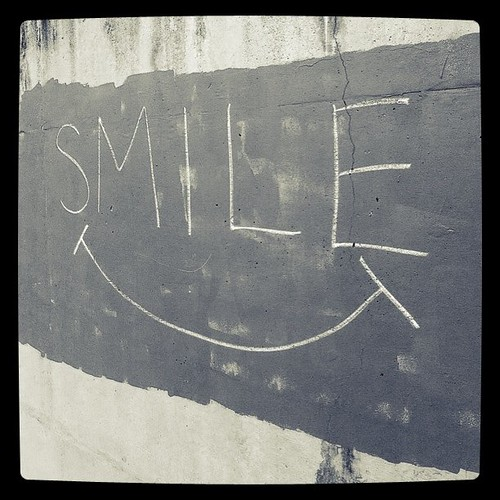 writing on the wall that says smile