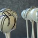 "Custom Vanilla Cake Pops with Black drizzle • <a style=""font-size:0.8em;"" href=""http://www.flickr.com/photos/59736392@N02/5501259908/"" target=""_blank"">View on Flickr</a>"