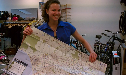LADOT intern Emily Dwyer shows off new LA bike maps at Flying Pigeon LA