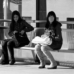 TRAMSTOP (Akbar Simonse) Tags: street girls people bw holland netherlands bench square waiting boots zwartwit candid streetphotography bank denhaag bags thehague wachten tramstop streetshot straat tramhalte straatfotografie straatfoto dedoka akbarsimonse