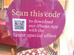 QR code in travel agent window (nickj365) Tags: smart poster code technology phone geek scanner tag content surrey scan smartphone future barcode data scanning dorking 2d tagging tracking app qr iphone qrcode travelagent encode kuoni kaywa beetagg quickmark physicalhyperlink inigma zxing realworldhyperlink mbarcode