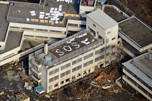 SOS Sign on the Building Roof