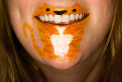 Tiger Teeth. (evilibby) Tags: girl smile face cat tooth mouth hair paint jaw teeth makeup lips human laugh blonde grin libby meow lipstick 365 facepaint blondehair chin mybedroom gingercat catmouth teefs 365days 3654 365days4 tigerteeth cheshirecatsmile mawf mfimc thiswasgoingtobebarnabee