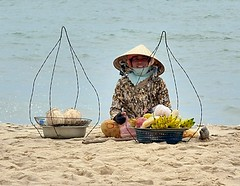 Fruit Seller (trevphotos) Tags: sea woman beach smile hat fruit asia coconut banana vietnam baskets vendor streetfood fruitseller muine cocunut earthasia lphats lphumble