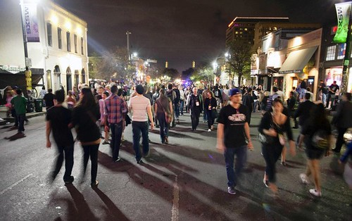 Sixth Street in downtown Austin is filled with pedestrians during the SXSW music festival