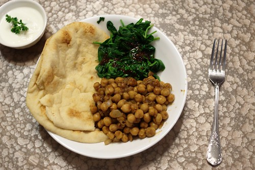 Spicy Indian Chickpeas with naan and wilted spinach