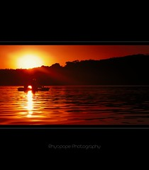 A Hot Afternoon On The Lake (rhyspope) Tags: sunset red people orange sun mountain lake black hot tree wet water silhouette yellow creek sunrise canon river person evening boat stream kayak glow afternoon ripple hill australia vessel lagoon bluemountains canoe burn human recreation aussie 500d wentworthfalls rhyspope