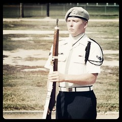 Me at twenty-one. On the riffle drill team, they gave us guns and taught us how to march. However, in the Air Force we don't shoot people, we push buttons. by ObieVIP