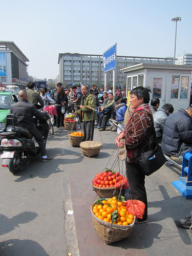 Selling Fruits Near Train Station