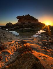 Setting over the Pillar (matt haysom) Tags: sunset sea seascape beach nature water landscape coast sand nikon rocks dusk australia victoria shore sorrento morningtonpeninsula sigma1020mm d40x