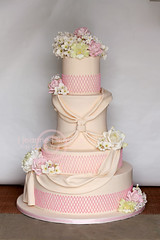 A butt-load of flowers... (The Well Dressed Cake) Tags: pink wedding white orchid green rose cake ivory round hydrangea