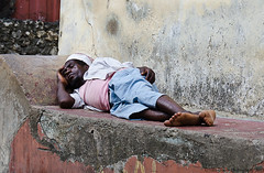 Sleeping it off (Ulla Jensen Photography) Tags: africa street sleeping man beer zanzibar stonetown homebrew pombe
