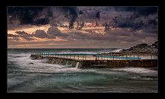 Gloomy Curl Curl (Kaj0 / kajophotography.com) Tags: morning blue light wild orange seascape wet water pool clouds fence landscape dawn waterfall fantastic rocks gloomy pacific teal sydney rail australia pacificocean nsw eastcoast rockpool d300 northernbeaches curlcurl kajo